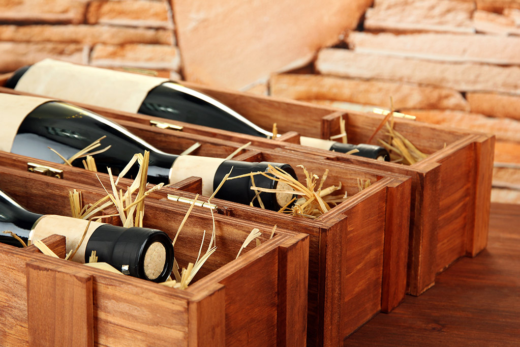 Fine wine bottles in small wooden boxes